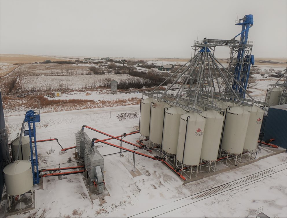 Seed Facility in Verwood, Saskatchewan featuring Batco Conveyors and Underbins, Westeel Smoothwall Bins, NECO Mixed Flow Grain Dryers, VIS Bucket Elevators, and a VIS Distributor Image